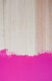 Splash of painted colour on pine plank Stock Photo