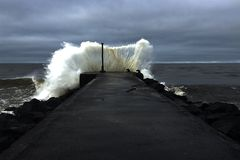 Splash. Perfectly timed shot of  a wave hitting the pier Stock Images