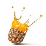 Splash of pineapple juice isolated Royalty Free Stock Images