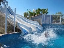 Splash, in the poolA TOBOBOGGAN GIANT WATER. IN CAMPING IN THE SEA stock images