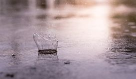 Splash of rain drop on surface of water, when it is raining. Fresh water droplets stock photography
