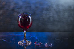 Splash in red juice or wine in a wineglass.  stock image