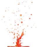 Splash of red liquid on white background Stock Image