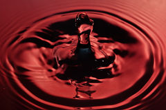 Splash in red tones Royalty Free Stock Photos