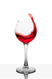 Splash of red wine in the cup filling Stock Photos