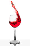 Splash of red wine in the cup filling Royalty Free Stock Photography