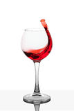 Splash of red wine in the cup filling Stock Image