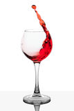 Splash of red wine in the cup filling Royalty Free Stock Images