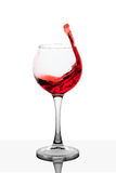Splash of red wine in the cup filling Stock Photo