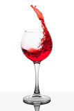 Splash of red wine in the cup filling Royalty Free Stock Image