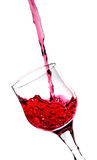 Splash in a red wine glass Royalty Free Stock Photography