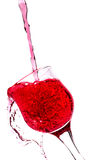 Splash in a red wine glass Stock Image