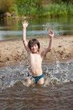 Splash in river Stock Images