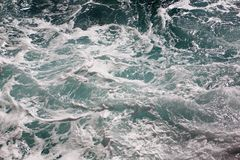 Splash of seawater with sea foam. Splash of seawater with waves and sea foam Stock Photo