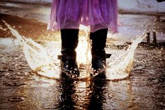 Splash. Someone& x27;s having fun in puddles Royalty Free Stock Photo