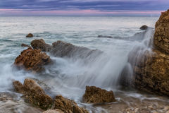 Splash and spray of waves against the rocks. Royalty Free Stock Photography