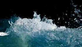 Splash of stormy water in the ocean on a black background.  Royalty Free Stock Photo