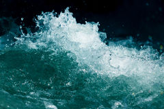 Splash of stormy water in the ocean on a black background.  Stock Photos