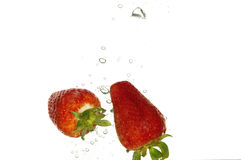 Splash strawberry in water Royalty Free Stock Image