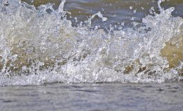 Splash. A sudden disturbance to the otherwise quiescent free surface of a liquid stock photos