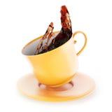 Splash of tea in cup Royalty Free Stock Image