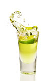 Splash of tequila from the falling pieces of lime Stock Photo