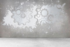Splash on wall revealing cogs and wheels Stock Image