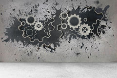 Splash on wall revealing cogs and wheels Royalty Free Stock Photo