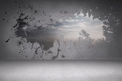Splash on wall revealing desert landscape Royalty Free Stock Image