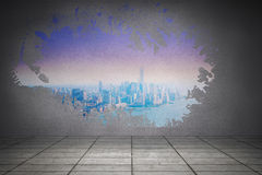 Splash on wall revealing purple and blue city Stock Photography