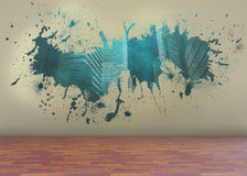Splash on wall revealing technology graphic Stock Photo
