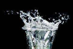 Splash water. Object on black - splash water close up stock photography