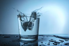 Splash of water on a blue background stock image