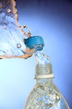 A splash of water from a bottle. Royalty Free Stock Photo