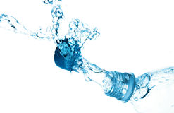 A splash of water from a bottle. Stock Photos