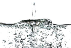 A splash of water,drops and bubbles on a white background Royalty Free Stock Image
