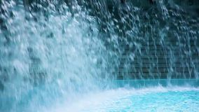 Splash of water on a pool. Splash of water falls down on the surface of a swimming pool stock video footage