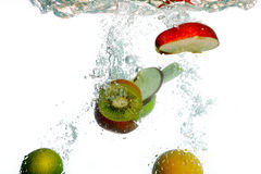 Splash water with freshnes fruits Stock Images