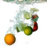 Splash water with freshnes fruits Stock Photo