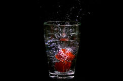 Splash in a water glass Stock Photography