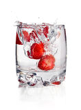 Splash water in glass with strawberry Stock Images