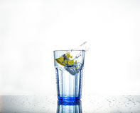 Splash of water with ice and lemon in a glass Royalty Free Stock Photography