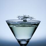 Splash water isolated on the Champagne glass. Water Drop Splash  on the Champagne glass,splash water isolated on a gray background Royalty Free Stock Images