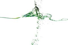 Splash of water of psychedelic green colors. On a white background closeup Royalty Free Stock Images
