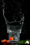 Splash. Water splash tomato mushroom eating fennel food glass light spray unusually wet beauty kitchen Royalty Free Stock Photography