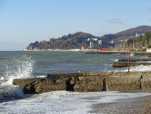 Splash of waves on the pier, Black Sea, coast Sochi. Coast Sochi, Russia, winter season Stock Image