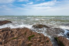 Splash of waves on a rocky seashore. Landscape royalty free stock image