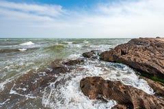 Splash of waves on a rocky seashore. Landscape royalty free stock photos