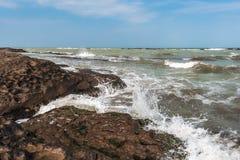 Splash of waves on a rocky seashore. Landscape royalty free stock photo