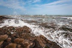 Splash of waves on a rocky seashore. Landscape stock photo